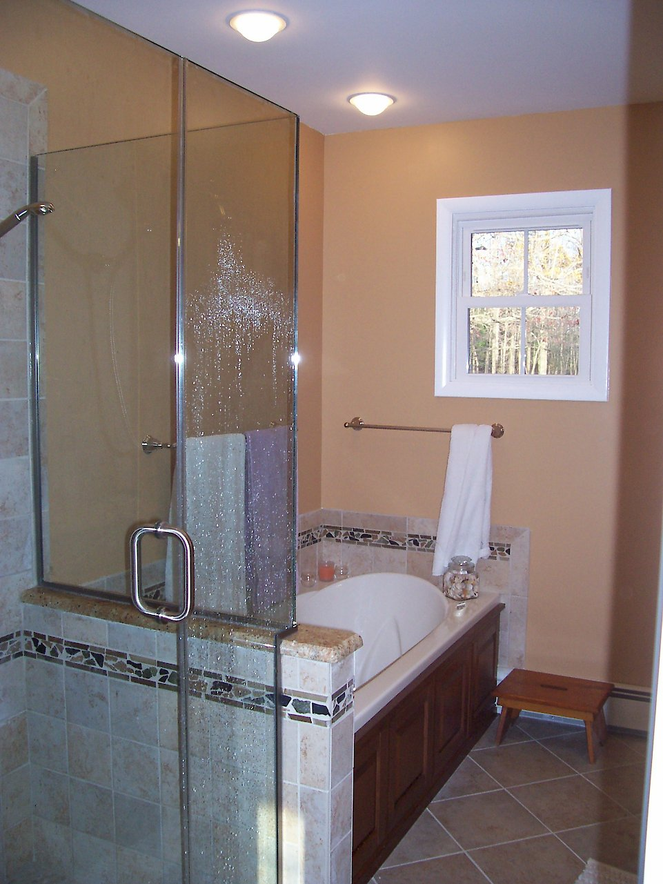Bain Ultra tub next to the shower.