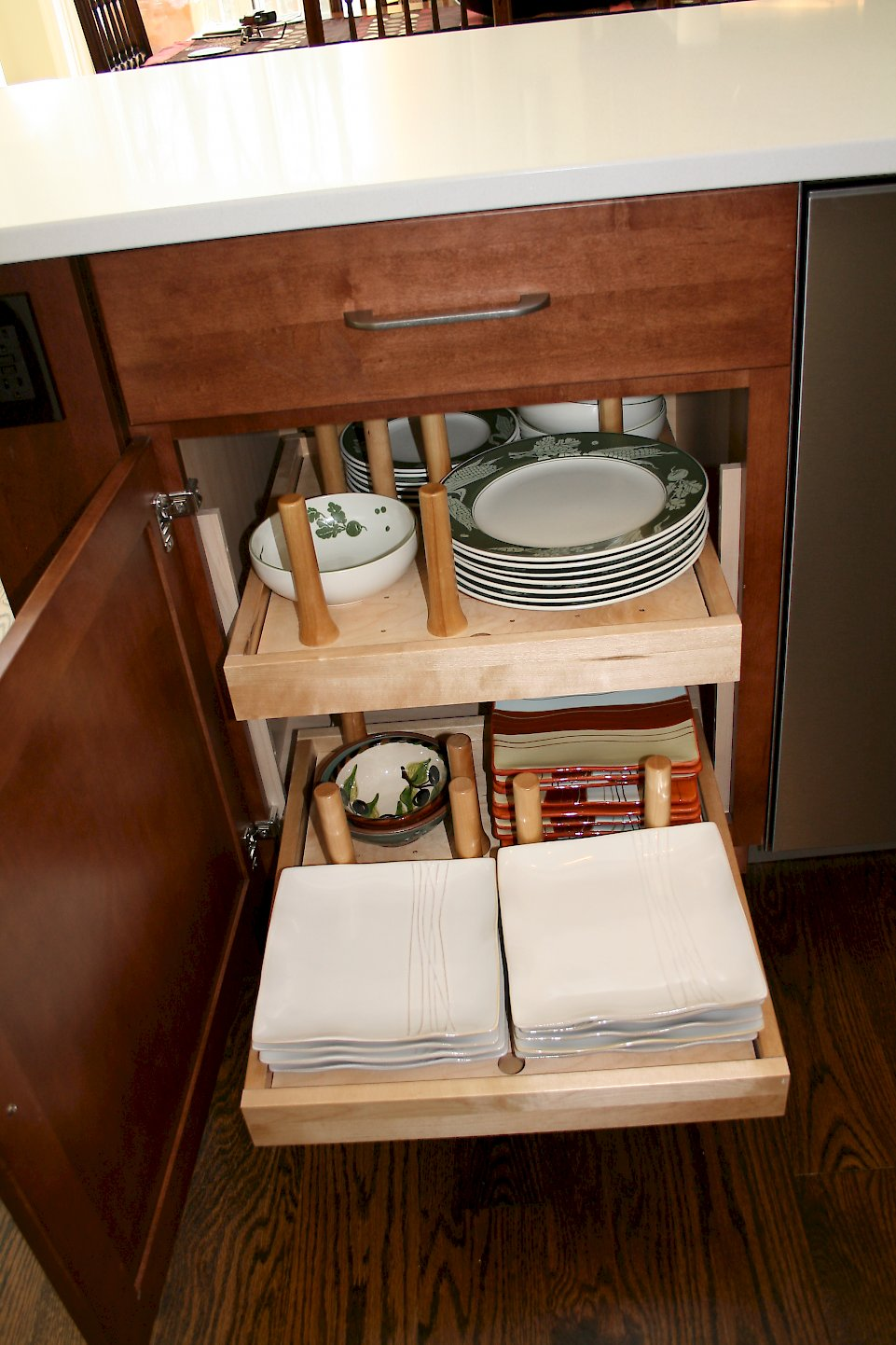 Pull out drawers with pegs to hold dishes.