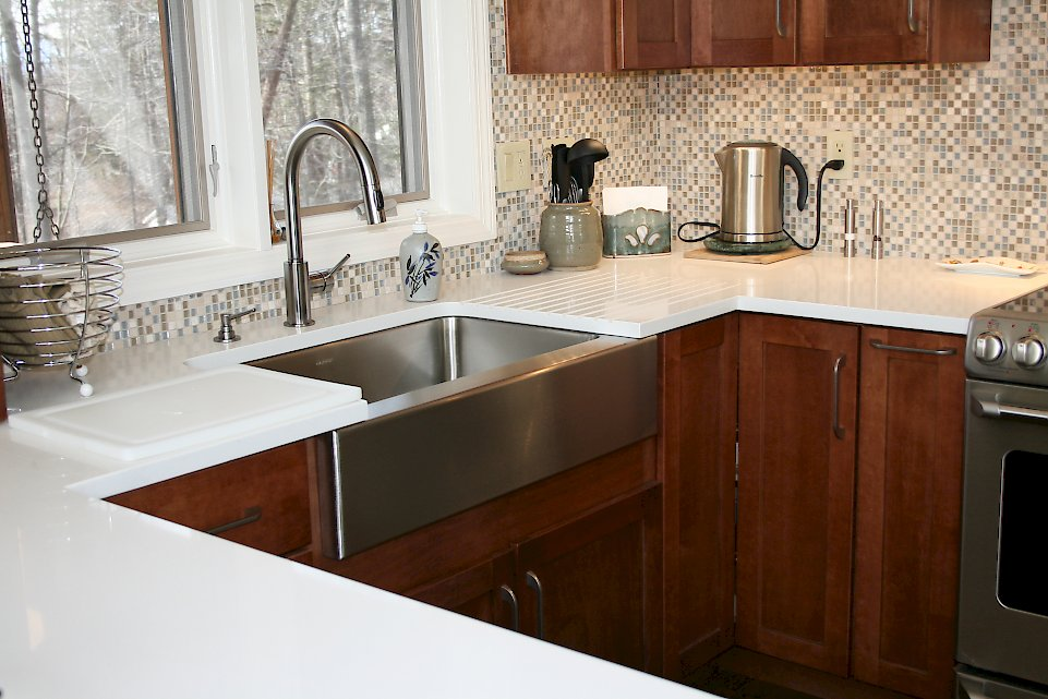 An Elkay farmhouse stainless steel sink.