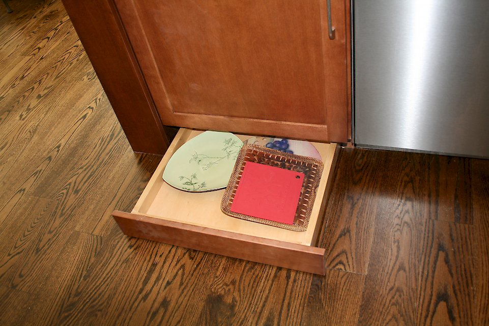 Small drawer next the dishwasher.