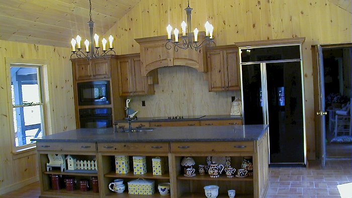 A rustic knotty cherry kitchen with honed ash black granite counter-tops.