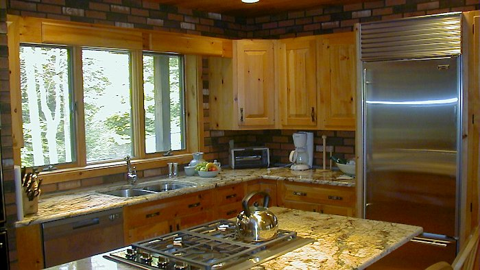 Juperana Persia Dark granite countertops on a rustic pine kitchen.