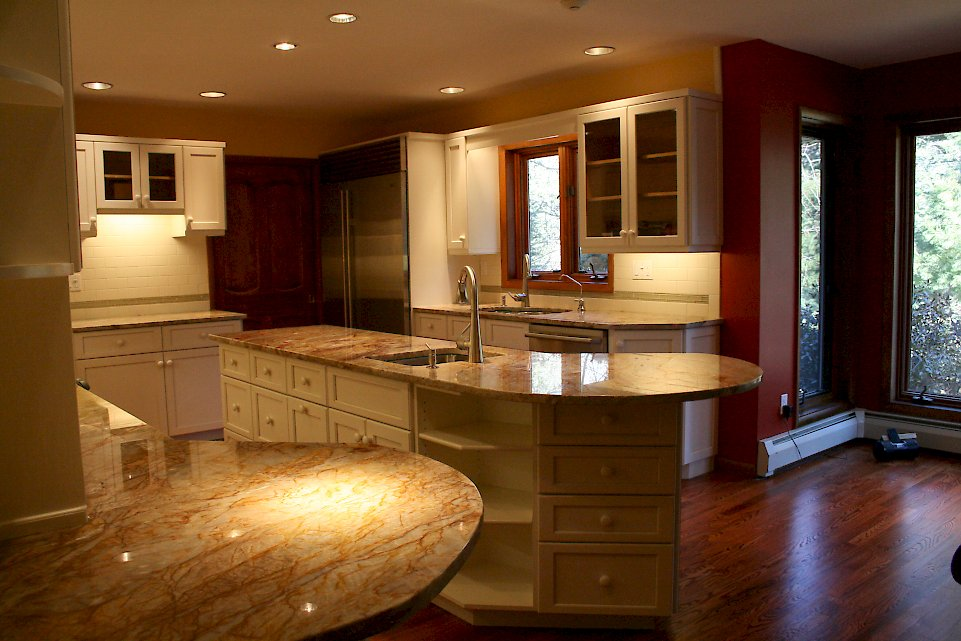 A kitchen refaced with white Conestoga doors.
