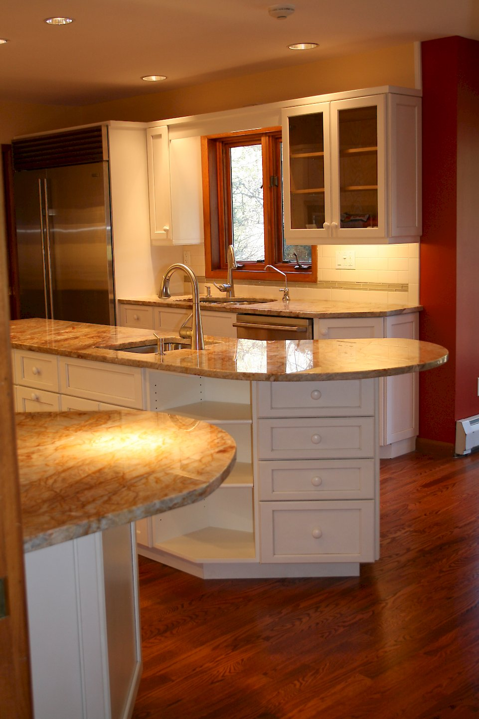 Plenty of drawers and open shelving in the kitchen island.