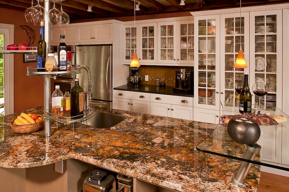Glass door cabinetry for wine glasses and dishs.