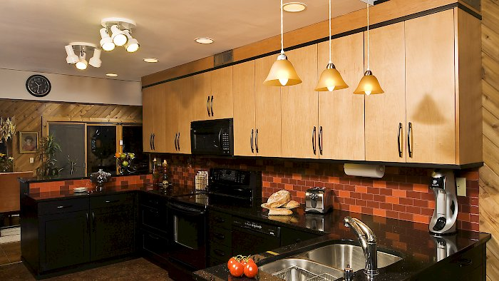 Two toned Brookhaven kitchen with galaxy black granite counters.