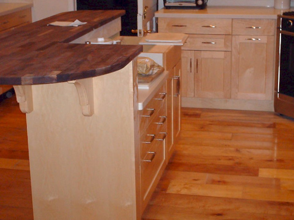 Black walnut butcher block counter on the island.