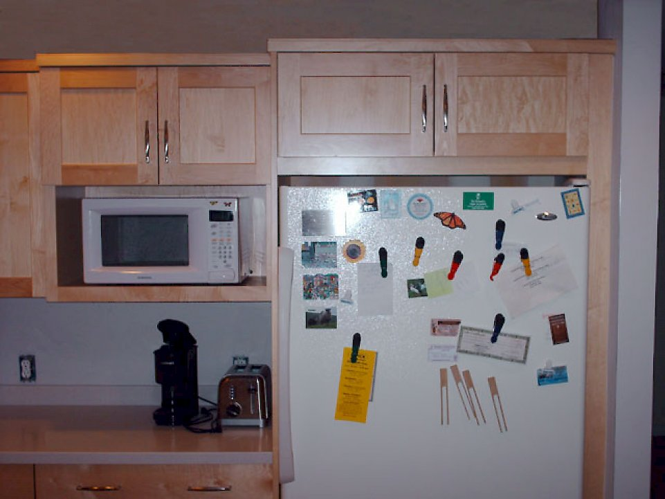 Cabinet over the refrigerator.