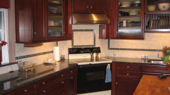 A maple cordovan brookhaven kitchen with the Pelhem Manor door style.