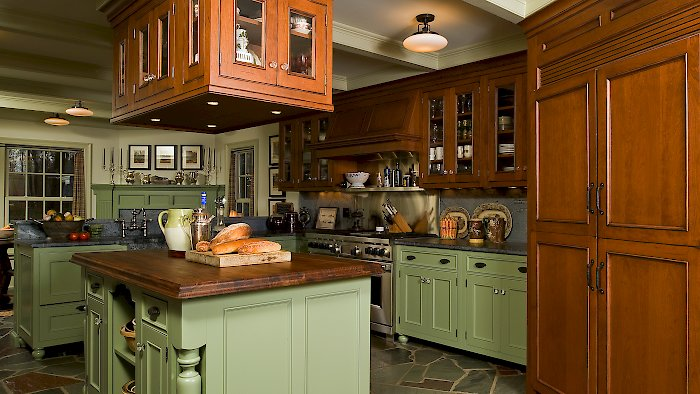 Wood-Mode Kitchen with an essex recessed door style, and custom green paint.