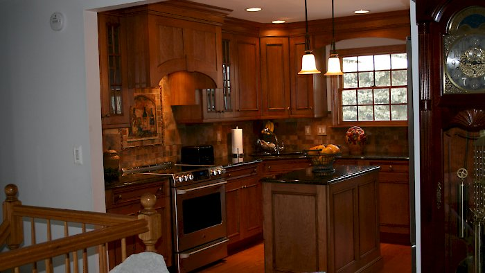 A rustic knotty cherry kitchen.