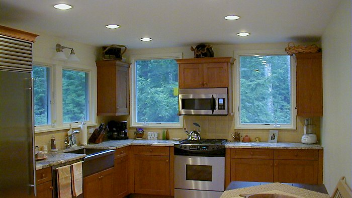 Cherry Wood-Mode kitchen with honed jupara persia granite counter-tops.