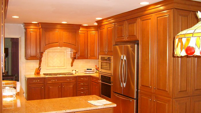 An autumn cherry kitchen with Wood-Mode Cabinetry.