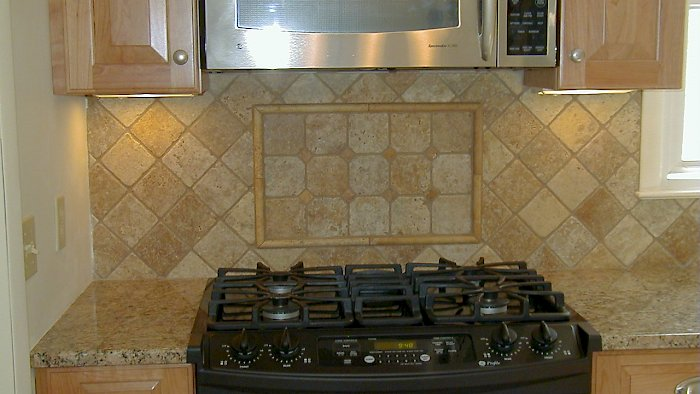 Closer view of the custom tiled backsplash.