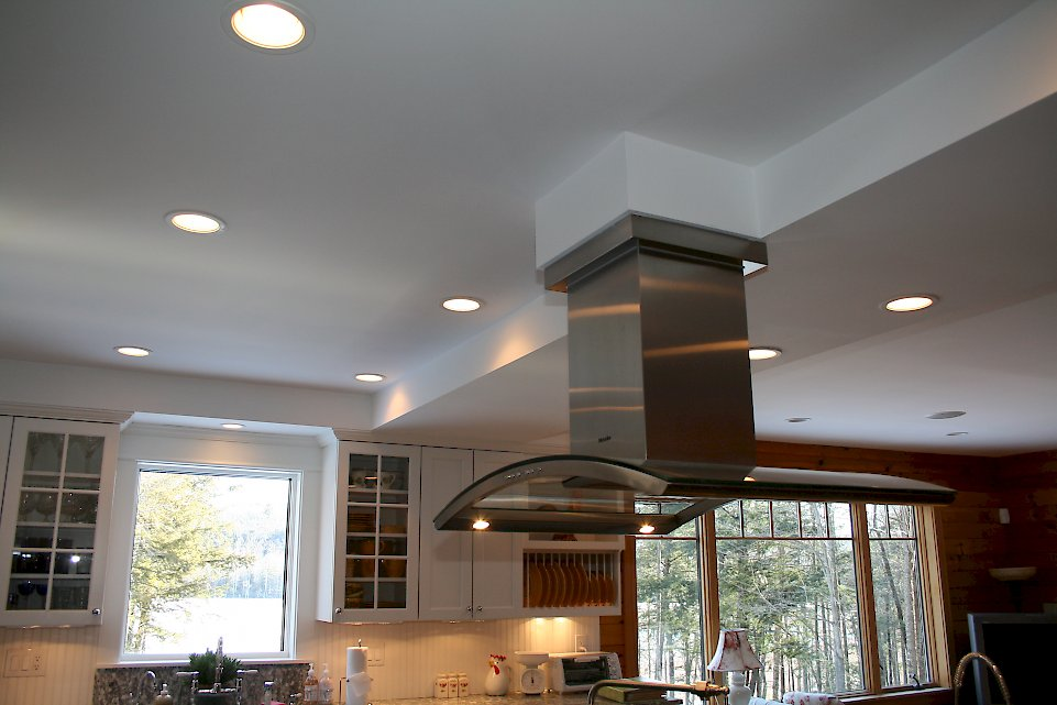 Stainless steel chimney hood above the rangetop.