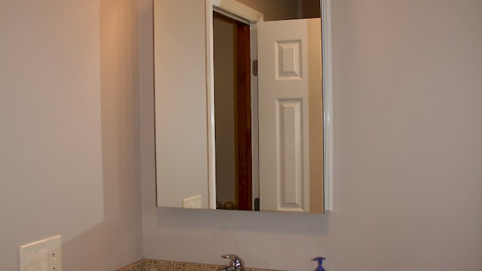 Maple vanity and Robern mirror/medicine cabinet.