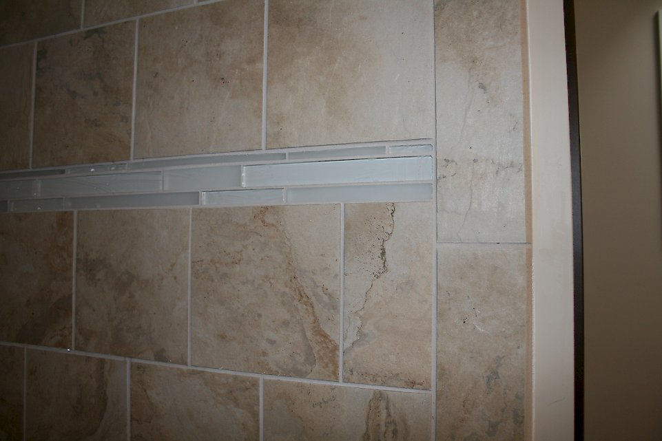 Glass tile accent in the shower.