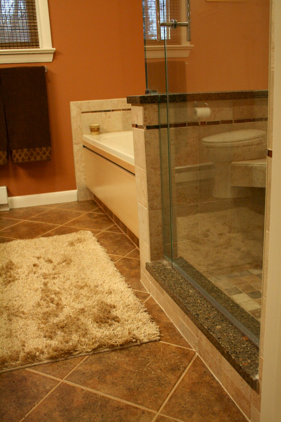 Cambria Ashford threshold on the shower curb.