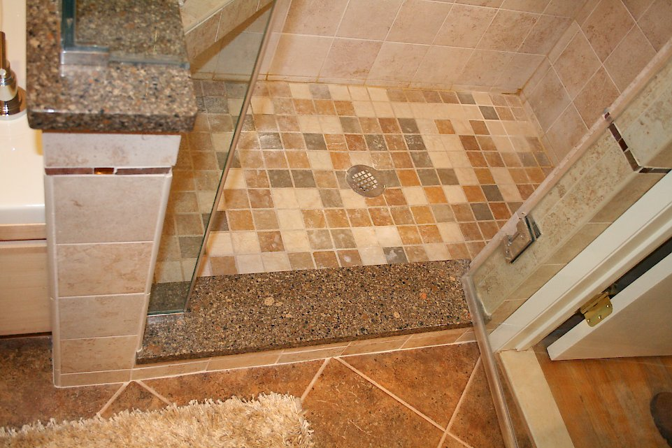 Multicolored tile on the shower floor.