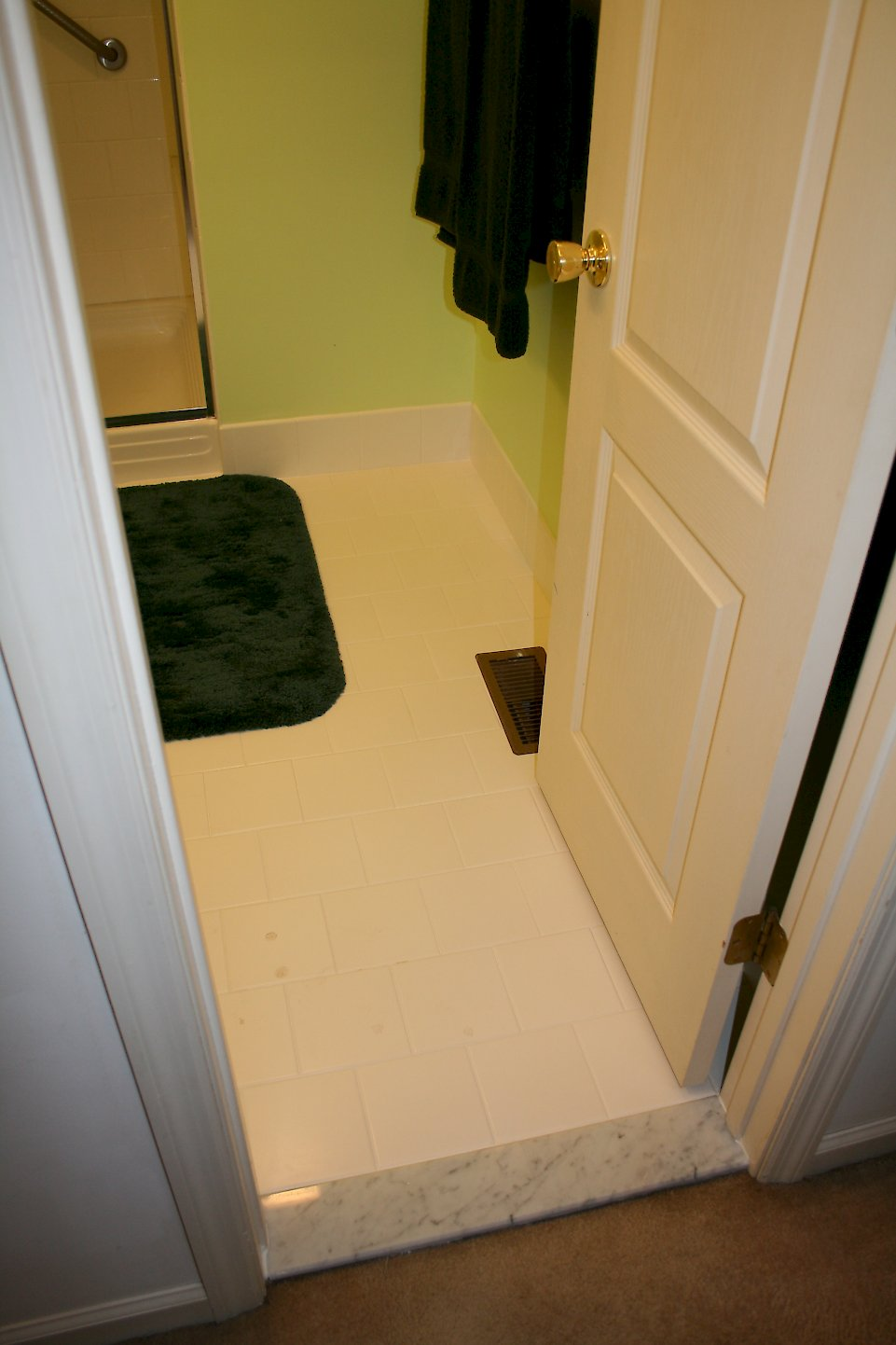 Marble threshold entering the bathroom.
