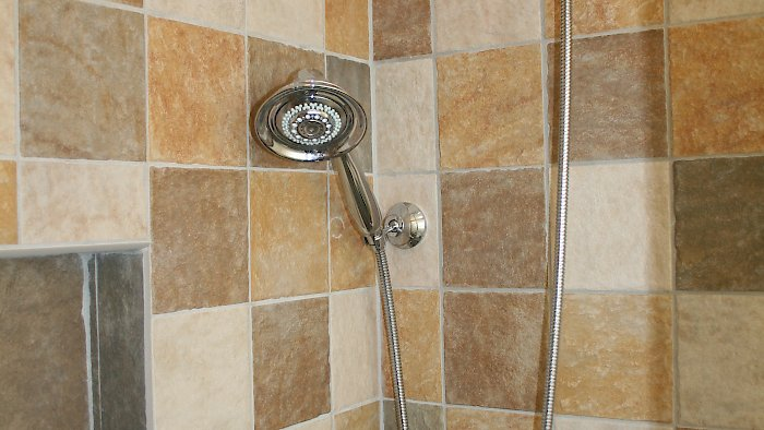 6x6 multicolored tile in the shower.